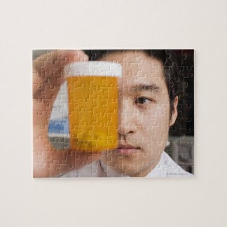 Man holding pill bottle jigsaw puzzle
