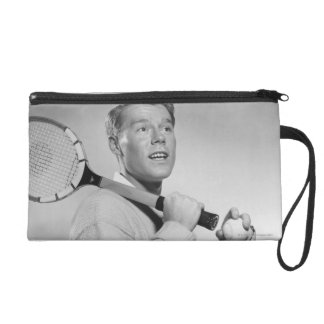 Man Holding Tennis Racket Wristlet Clutches