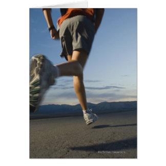 Man in athletic gear running card