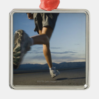 Man in athletic gear running christmas ornament
