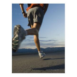 Man in athletic gear running postcard