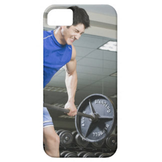 Man in gym, lifting large barbell, clenching case for the iPhone 5
