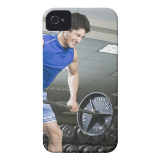 Man in gym, lifting large barbell, clenching iPhone 4 Case-Mate case