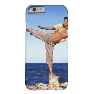Man in martial arts kicking position, on beach, barely there iPhone 6 case