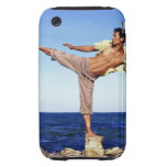 Man in martial arts kicking position, on beach, tough iPhone 3 covers