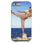 Man in martial arts kicking position, on beach, tough iPhone 6 case