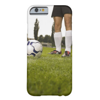 Man in soccer uniform standing with soccer ball barely there iPhone 6 case