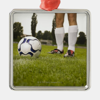 Man in soccer uniform standing with soccer ball christmas ornament