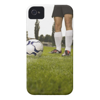 Man in soccer uniform standing with soccer ball iPhone 4 Case-Mate cases