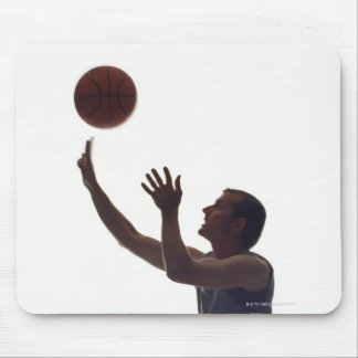 Man in wheelchair playing with basketball mouse pad