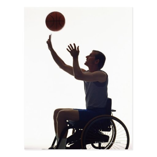 Man in wheelchair playing with basketball postcard