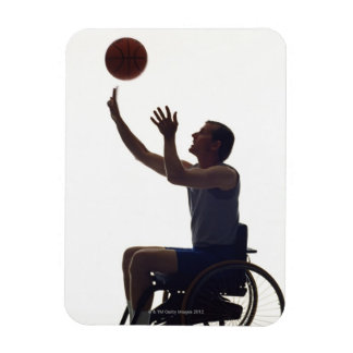 Man in wheelchair playing with basketball rectangular photo magnet