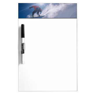 Man jumping off a large cornince on a snowboard dry erase board