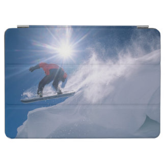 Man jumping off a large cornince on a snowboard iPad air cover