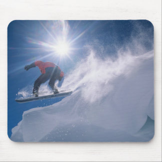 Man jumping off a large cornince on a snowboard mouse pad