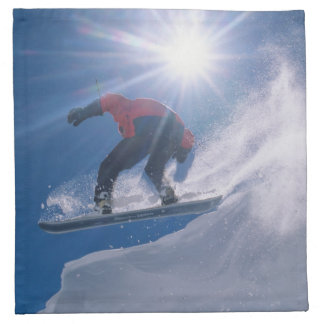 Man jumping off a large cornince on a snowboard napkin