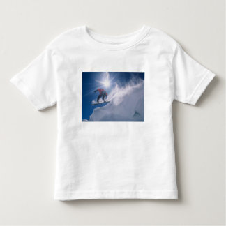 Man jumping off a large cornince on a snowboard toddler T-Shirt