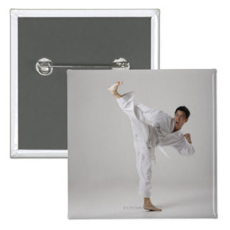 Man kicking high in the air, martial arts 15 cm square badge
