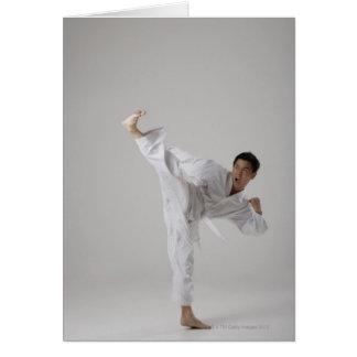 Man kicking high in the air, martial arts card