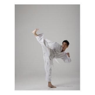 Man kicking high in the air, martial arts postcard