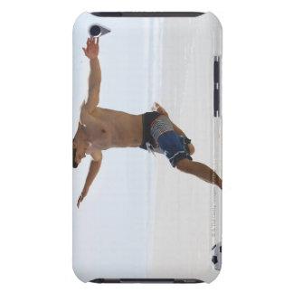 Man kicking soccer ball on beach iPod touch case