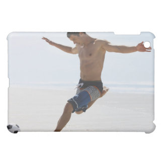 Man kicking soccer ball on beach case for the iPad mini