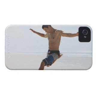Man kicking soccer ball on beach iPhone 4 Case-Mate case