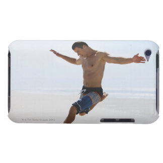 Man kicking soccer ball on beach iPod touch cover