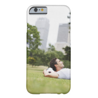 Man laying in urban park with soccer ball barely there iPhone 6 case