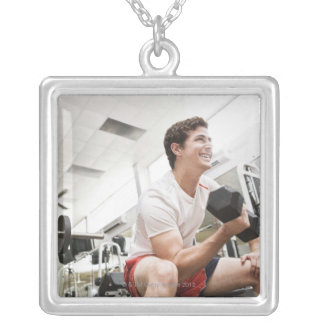 Man lifting dumbbells square pendant necklace
