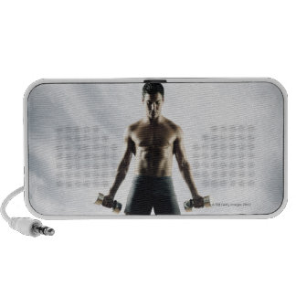 Man lifting weights 3 portable speakers