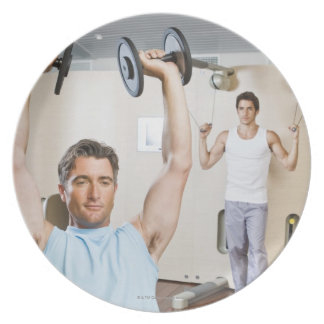 Man lifting weights at gym party plate