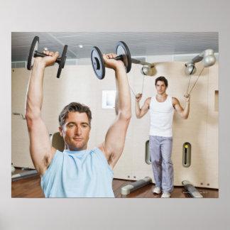 Man lifting weights at gym poster