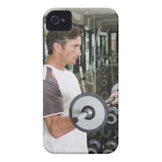 Man lifting weights in gym 2 iPhone 4 cases