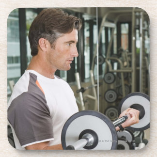 Man lifting weights in gym 2 coaster