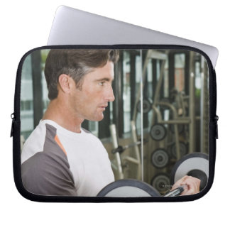 Man lifting weights in gym 2 laptop sleeve