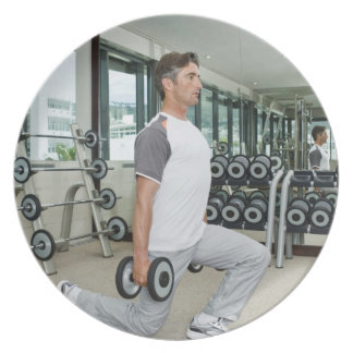 Man lifting weights in gym plates