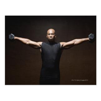 Man lifting weights, portrait postcard