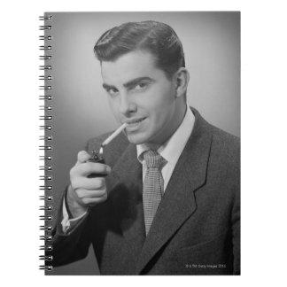 Man Lighting Cigarette Notebooks