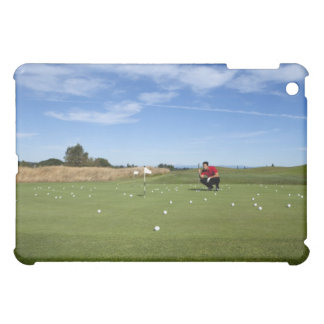 Man lining up a putt while golfing. case for the iPad mini