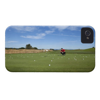 Man lining up a putt while golfing. iPhone 4 covers