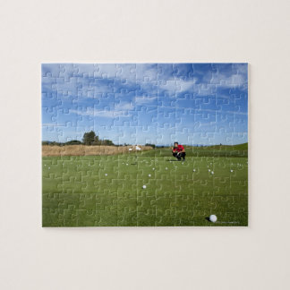 Man lining up a putt while golfing. jigsaw puzzle