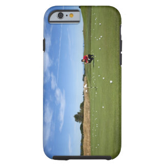 Man lining up a putt while golfing. tough iPhone 6 case