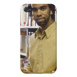 Man listening to music with headphones in iPhone 4/4S case