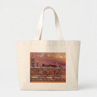 MAN LYING ON A WALL TOTE BAGS