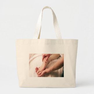 Man Massaging Male Foot Large Tote Bag
