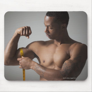 Man measuring his triceps mouse mat