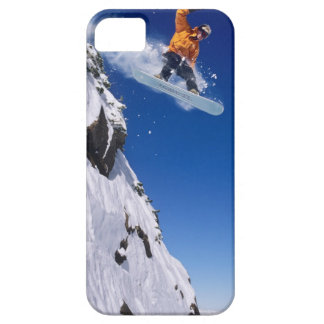 Man on a snowboard jumping off a cornice at case for the iPhone 5