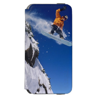 Man on a snowboard jumping off a cornice at incipio watson™ iPhone 6 wallet case