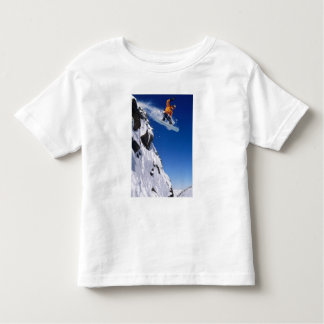 Man on a snowboard jumping off a cornice at toddler T-Shirt